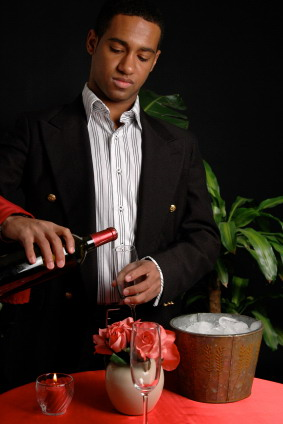 A waiter pouring wine in a fine restaurant
