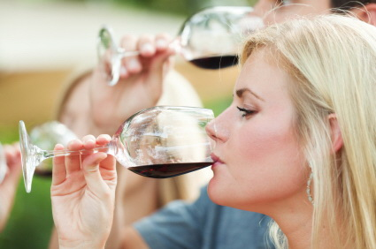 tasting wine blond woman