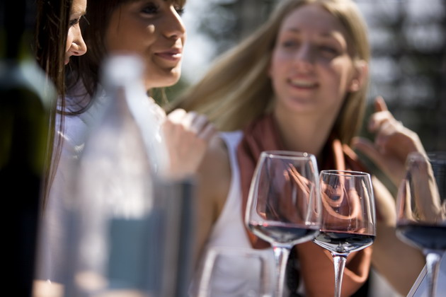 women wine outdoors 630