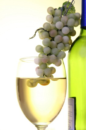 grapes going into wine glass