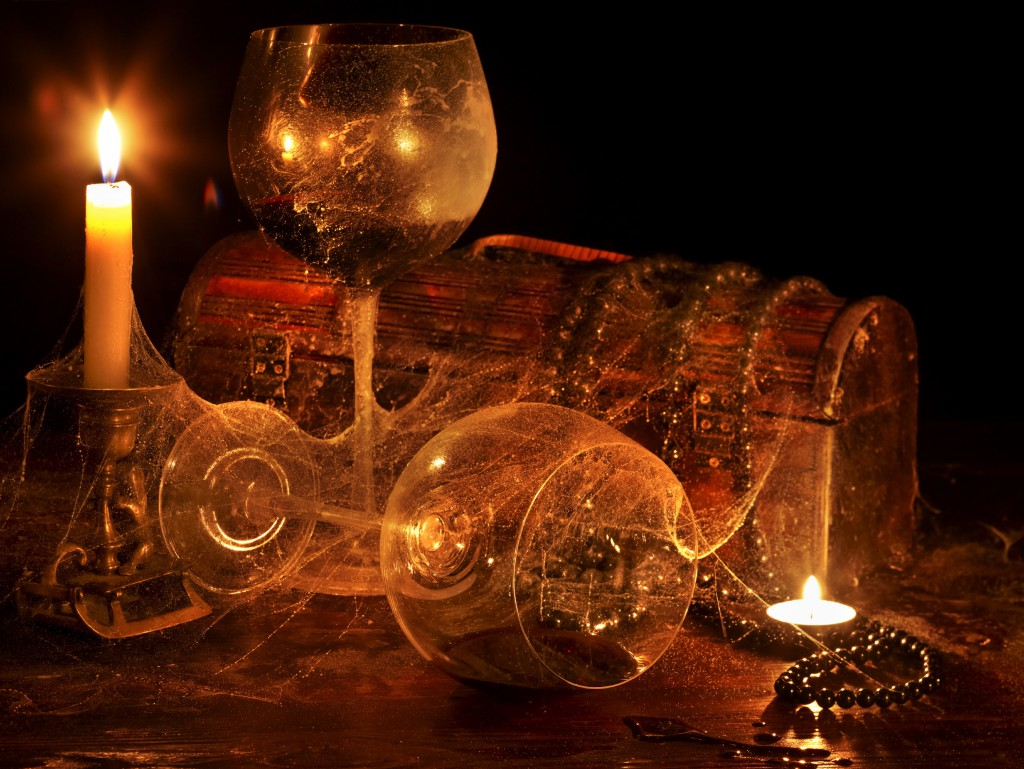 Two wine glass and candle on dark