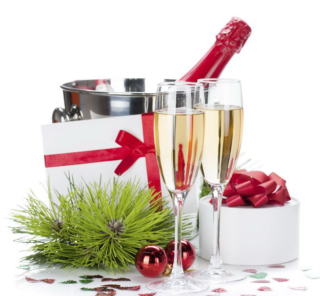 Champagne and christmas gifts. Isolated on white background
