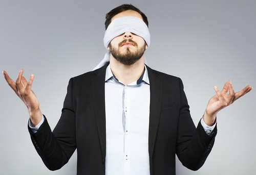 blindfolded office man undecided, on grey background