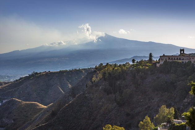 The famous view of Etna volcano from historical city Taormina, Sicily, Italy