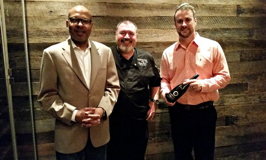 Kim Crawford 3 men standing July 16, 2015
