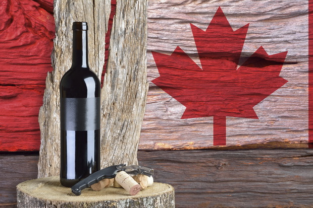 bottle of wine with Canada flag in the background