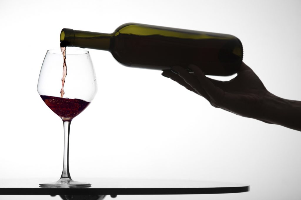 pouring wine into glass xl